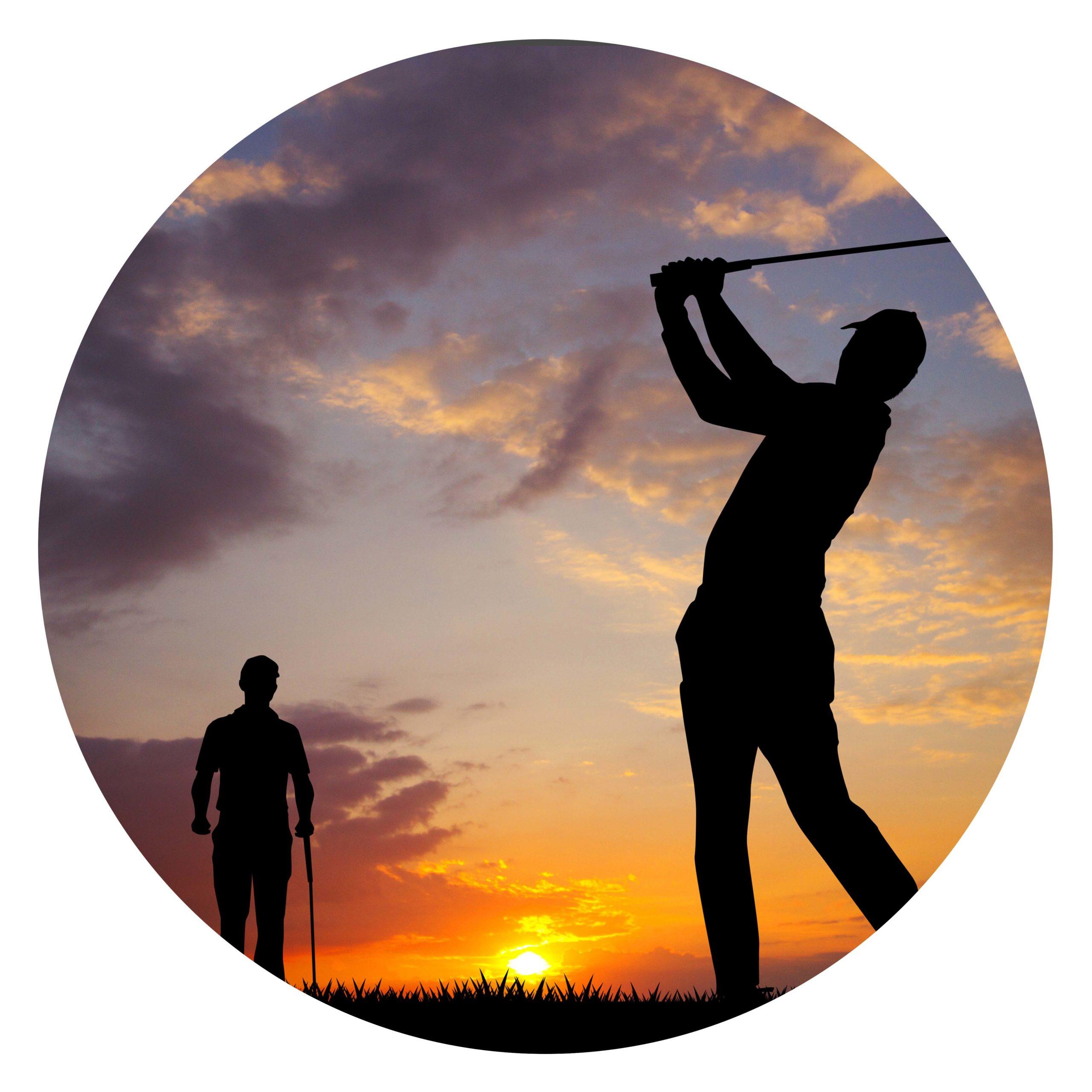 Two men golfing at twilight